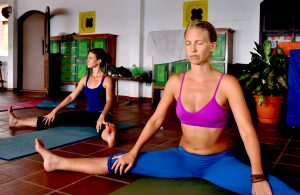 Two women performing yoga