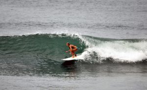 Woman surfing in the pocket of the wave