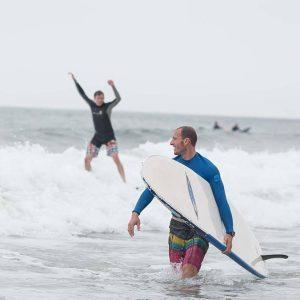 Tyler Trafas teaching a surf lesson